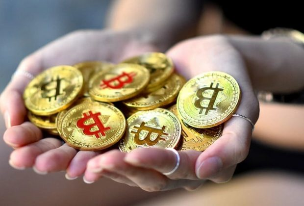 hands-holding-bitcoin-gold-btc-blockchain