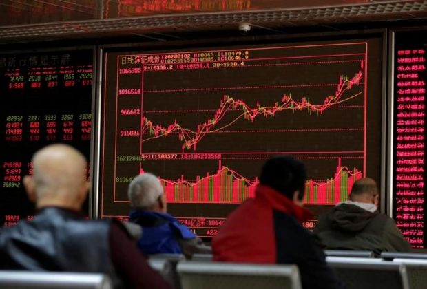 FILE PHOTO: A board shows stock information at a brokerage office in Beijing, China January 2, 2020. REUTERS/Jason Lee